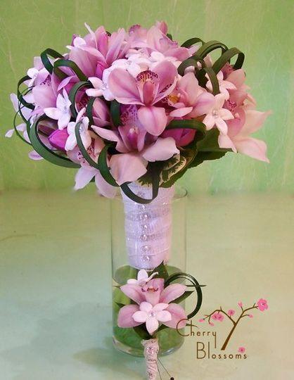 Stephanotis, roses, and cymbidium orchids