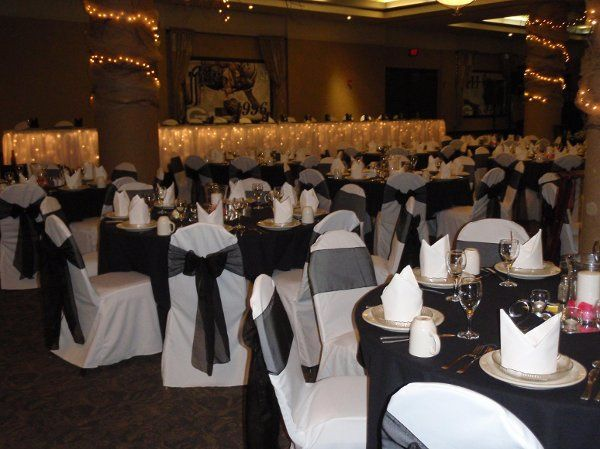 Chair covers with black sheer sashes
