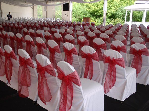Chair covers with red sashes at the 