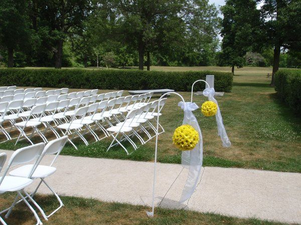 outdoor white wedding chairs and shepherd hooks. Location Pamperin Park Green Bay   Rental items