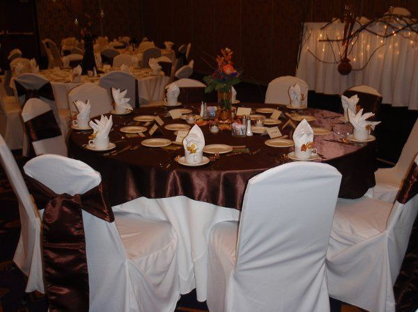 Rental chair covers, sashes and satin table overlay in chocolate brown