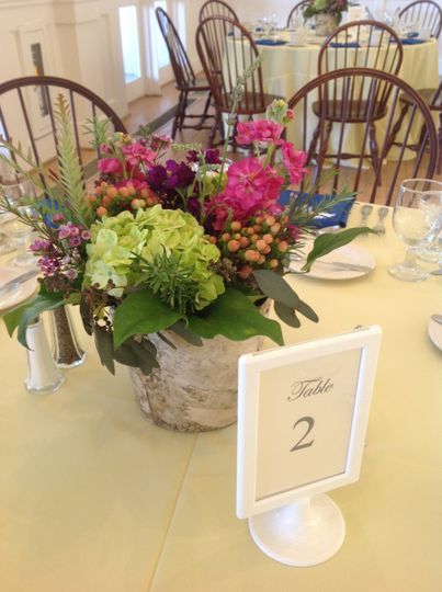 Table number and flower centerpiece