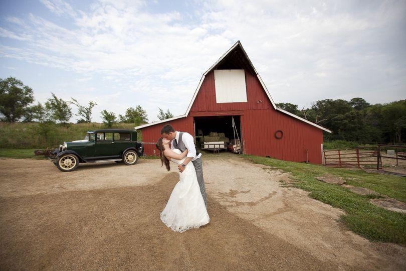 Kiss outside the barn
