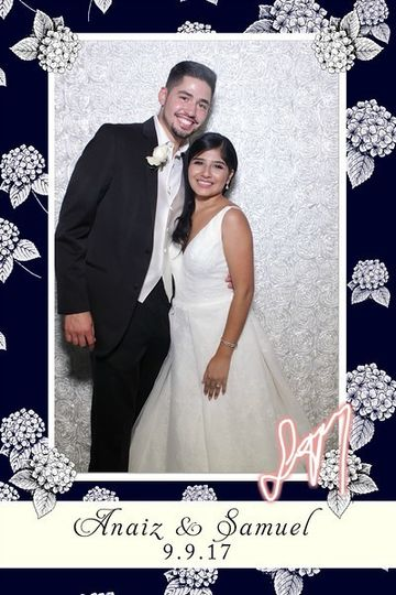 Navy blue and floral strip with a white rosette backdrop.   Signature feature in the bottom right!
