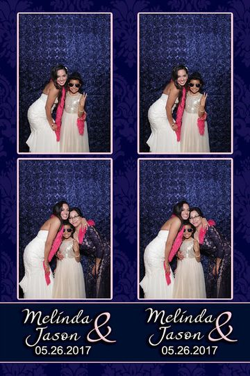 """Navy rosette backdrop on 2"""" x 6"""" strips with 2 photos."""