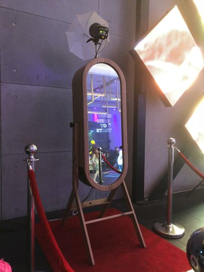 Red carpet and stanchions available for both mirror booths!