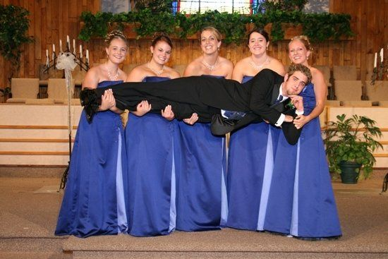 Groom held up in the bridesmaid's arms.