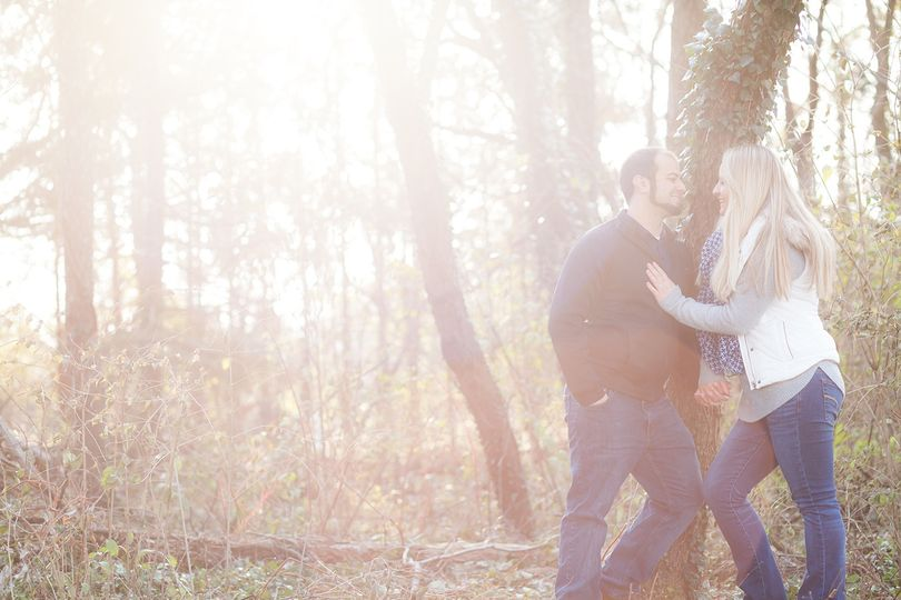 Happy couple posing in forest