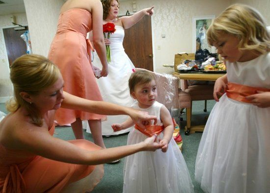 The bride, bridesmaids and little ones get ready before this wedding in Andover, Kansas....