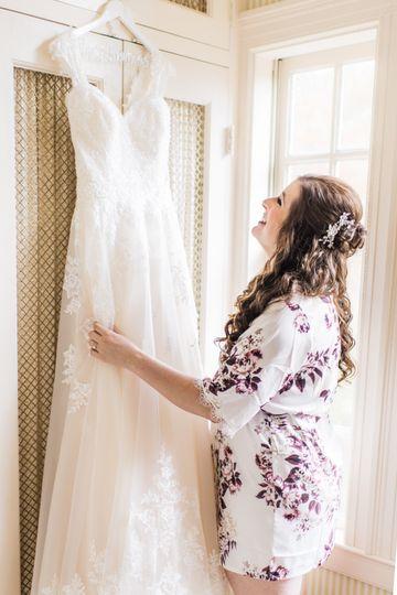 Bride adorning her dress