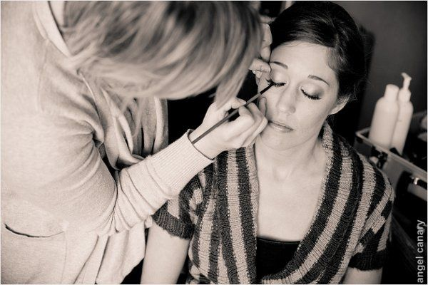 Makeup Artist Ashley Renee Salazar applying false eyelashes to a bride.  Lashes can really enhance...