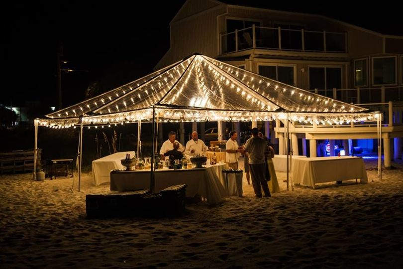 A Marry Me Rentals clear view tent and cafe lighting is very romantic