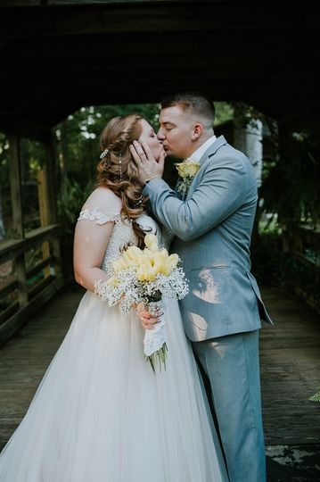 Beautiful bride kissing her partner