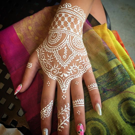 """""""White henna"""" is a long lasting body paint. It can last 1-3 days and is removable with alcohol or..."""