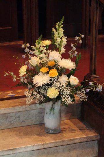 A stunning ceremony bouquet at the front of the church