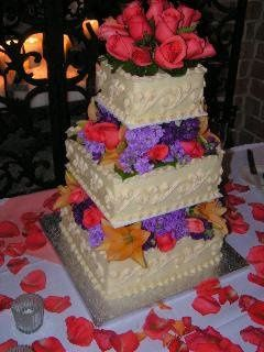 This is a three tier, square Wedding cake. Each tier was a different flavor.  Top tier three layer...