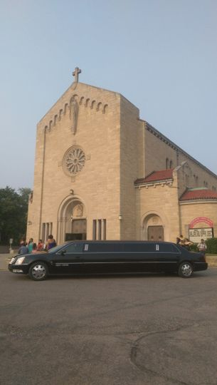 Our 10 passenger Cadillac DTS limousine dropping the wedding party off at a beautiful church in the...