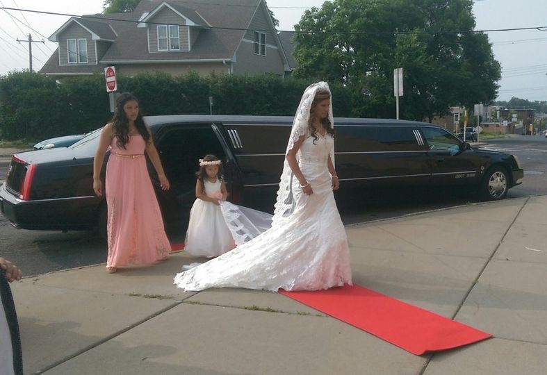 Red carpet roll out for a bride arriving to her wedding!