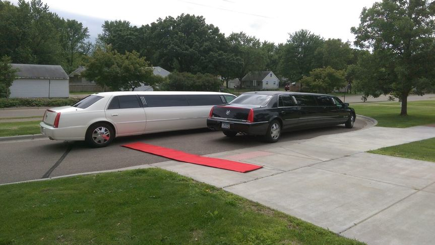 """Use one or both of our cars for your special day, be sure to ask for the """"Red Carpet Service"""""""