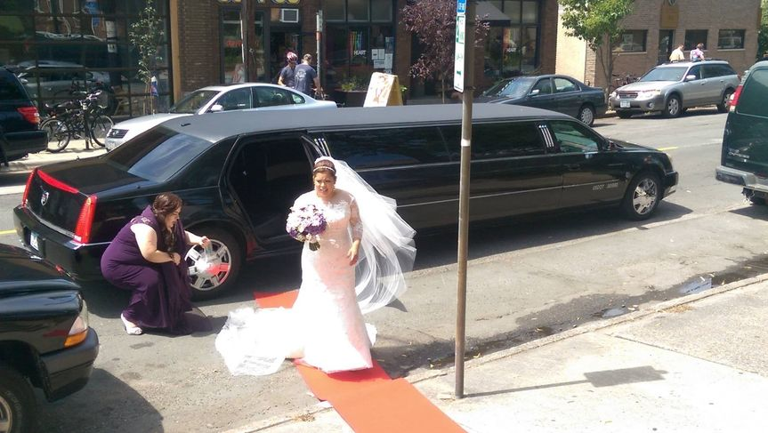 """Bride arriving to the church with our """"red carpet"""" rolled out for her!"""