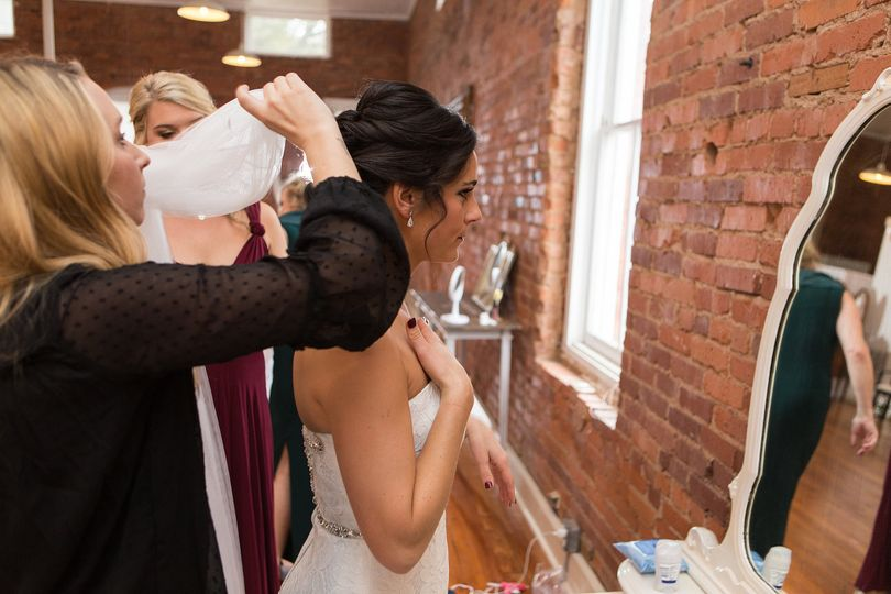 Assisting the bride