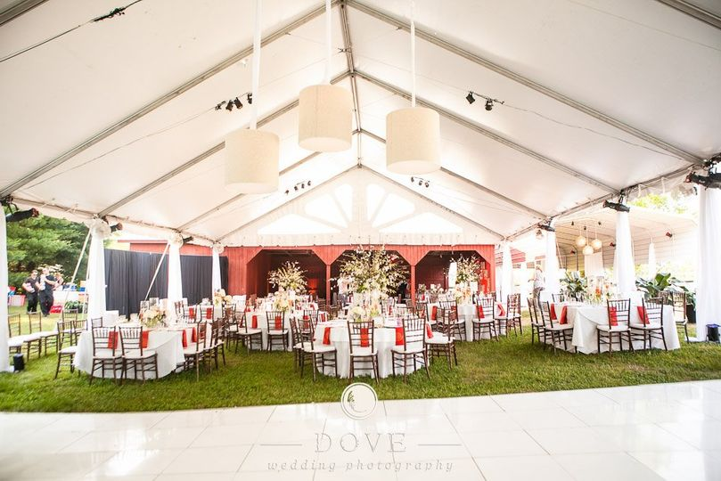 Perfect fall reception setup. Dance floor, tent, tables, chairs, linens, china, glassware, flatware...