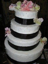 4 tier round.  White buttercream with hand-molded gumpaste orchids