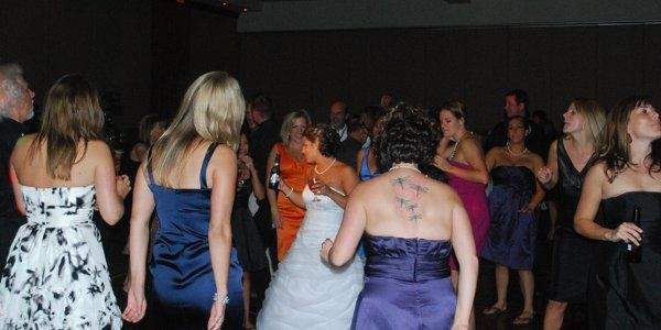 The bride with her guests dancing