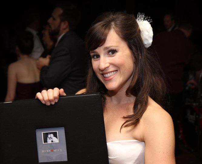 Becky, a very happy bride holding her Snapfuze Photo Guestbook