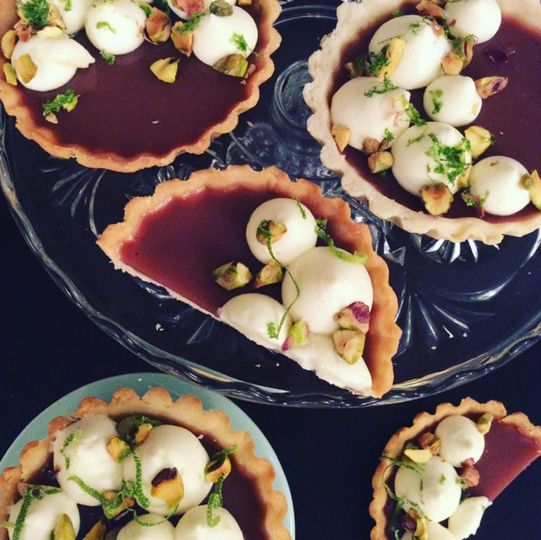 Guava tarts with buttermilk pastry cream, pistachios, and lime zest.