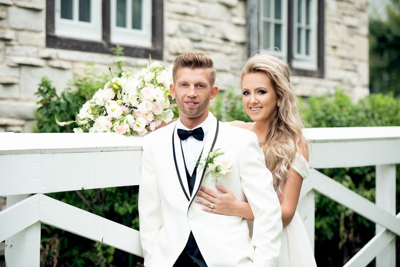 Newlyweds in white for their special day