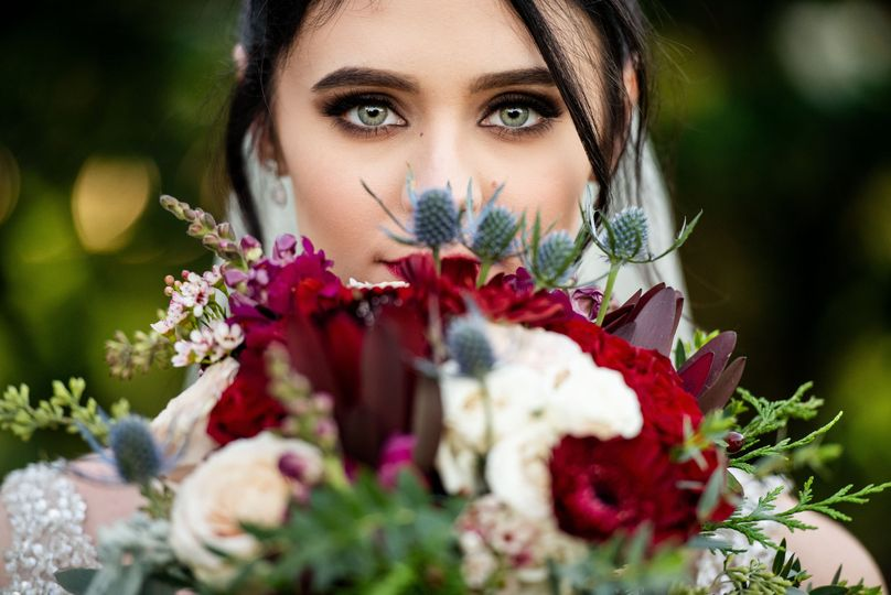 bride hiding floral bouquet 51 403963 v1