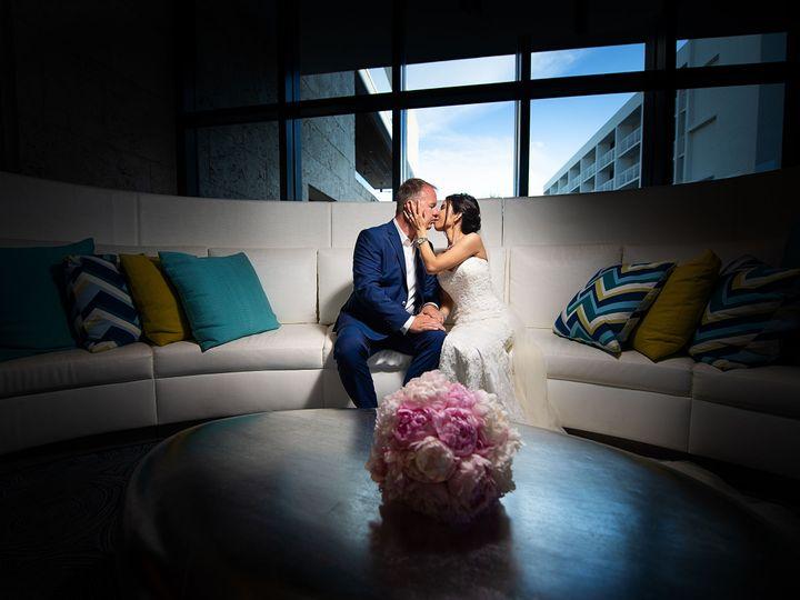 Tmx 1531758582 4efd7c687be64569 1531758532 71c553b13f9f9ab0 1531758525333 16 Couple Kiss Sofa  Sarasota, FL wedding photography