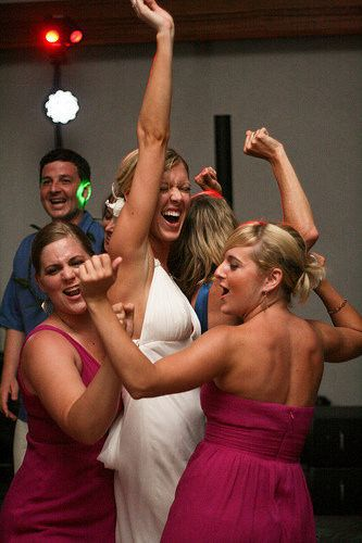 Dancing bride and bridesmaids