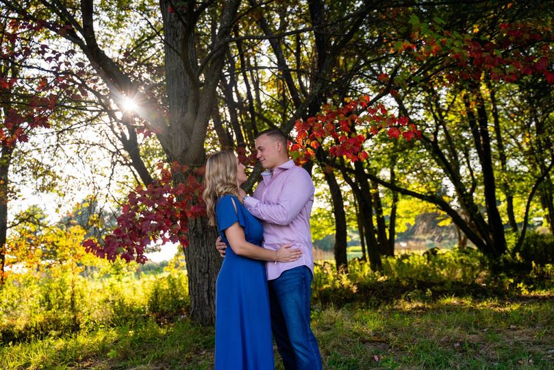 Engaged couple and fall trees