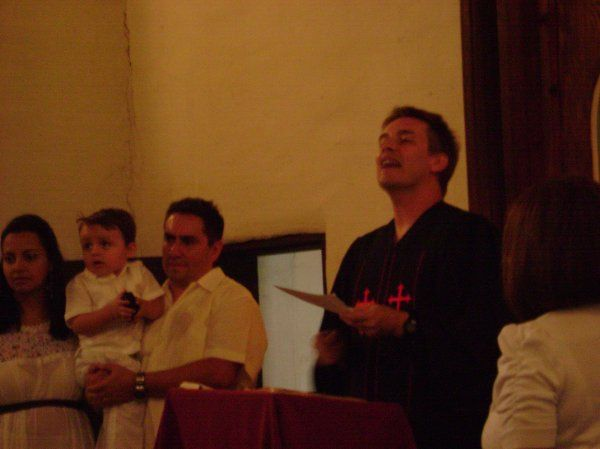 Rev. Mark performs a baby dedication at the Asistencia Mission in Redlands.