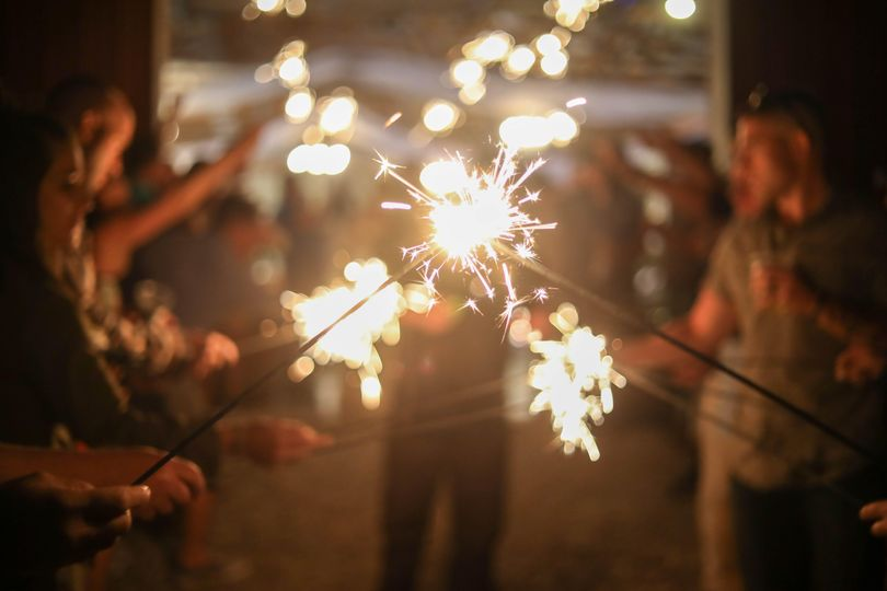 Sparklers in front of barn