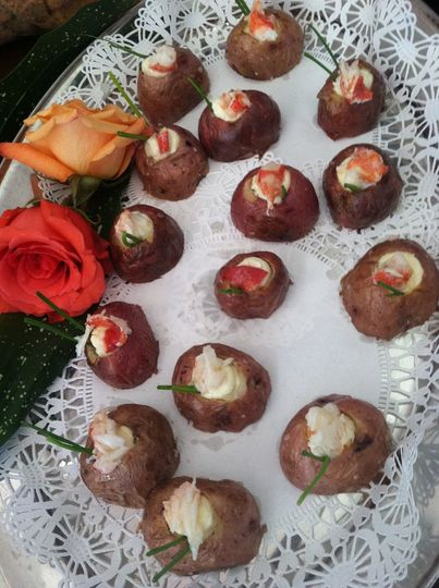 Baby New Potatoes filled with Lemon Infused Mascarpone topped with buttered Lobster garnished with...