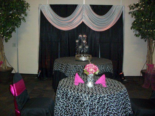 pipe and drape, cake plateau, centerpiece, chaircovers, sash, napkins