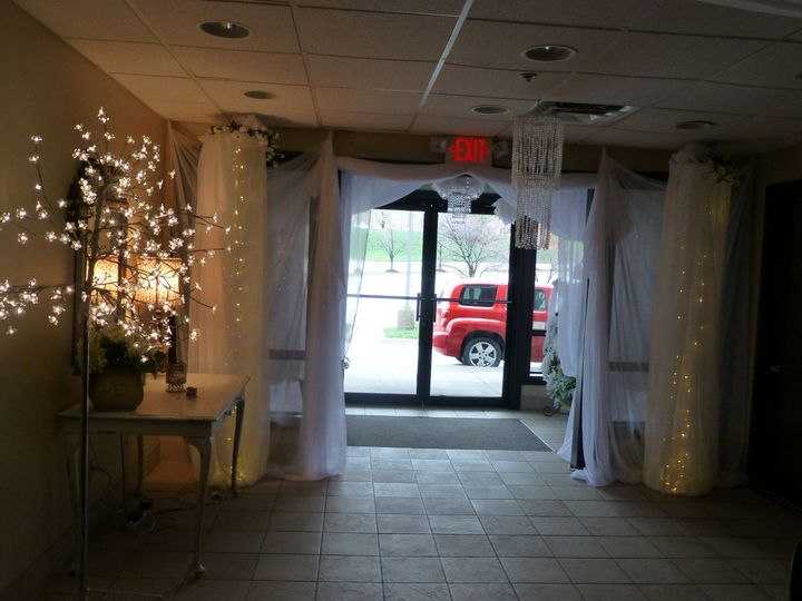 Grand Entrance with two lighted columns and drapery