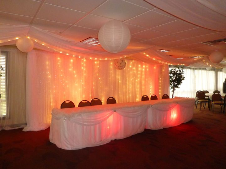 2 panel backdrop and 2 head tables. Uplights come in 16 colors and white strands of lights on...