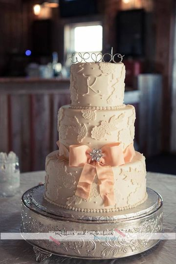 3-tier cake with blush ribbon