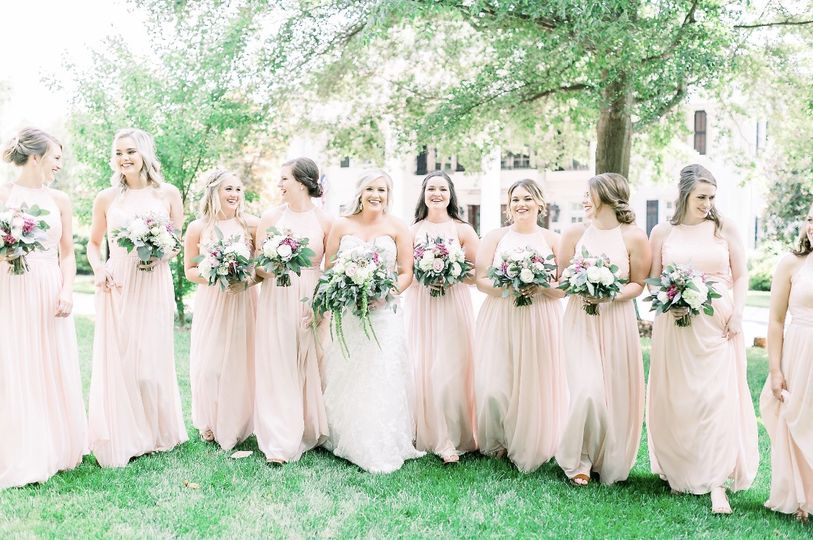 Bride, bridesmaids, and their bouquets