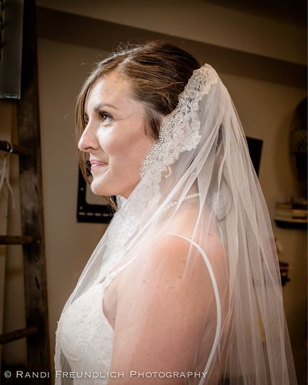 Bride wearing her veil