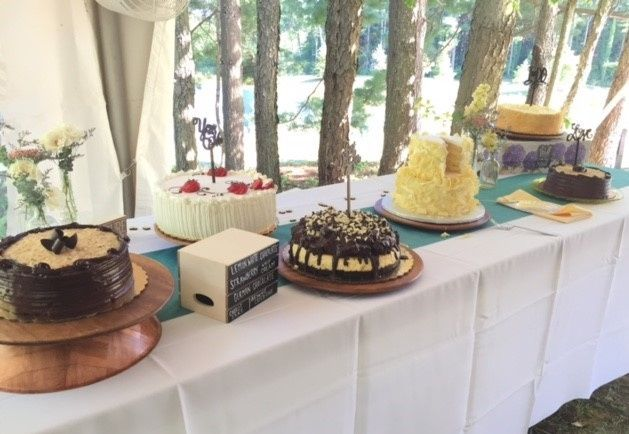 Reception Tent - The trees are a perfect backdrop to a tasty cake table.