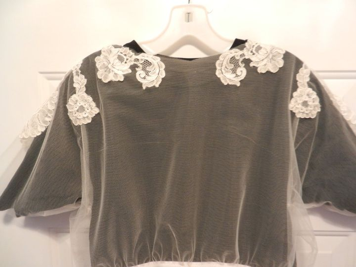 This is a modesty blouse of appliqued lace on tulle for bride's whose shoulders need to be covered...