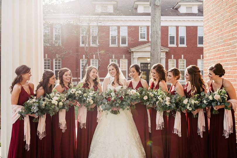 Bridesmaids on steps of chapel