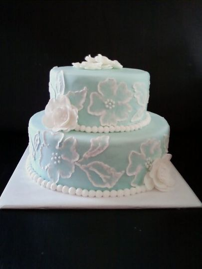 Blue Fondant with royal icing brushed embroidery floral design and white gum paste flowers