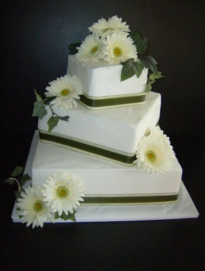 Buttercream icing with silk Gerber Daisies