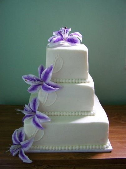 Basic 3 tier with buttercream icing and silk flowers